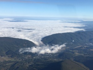 Low cloud layer flowing into a valley